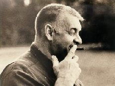 A classic photograph of Loren with a cigar